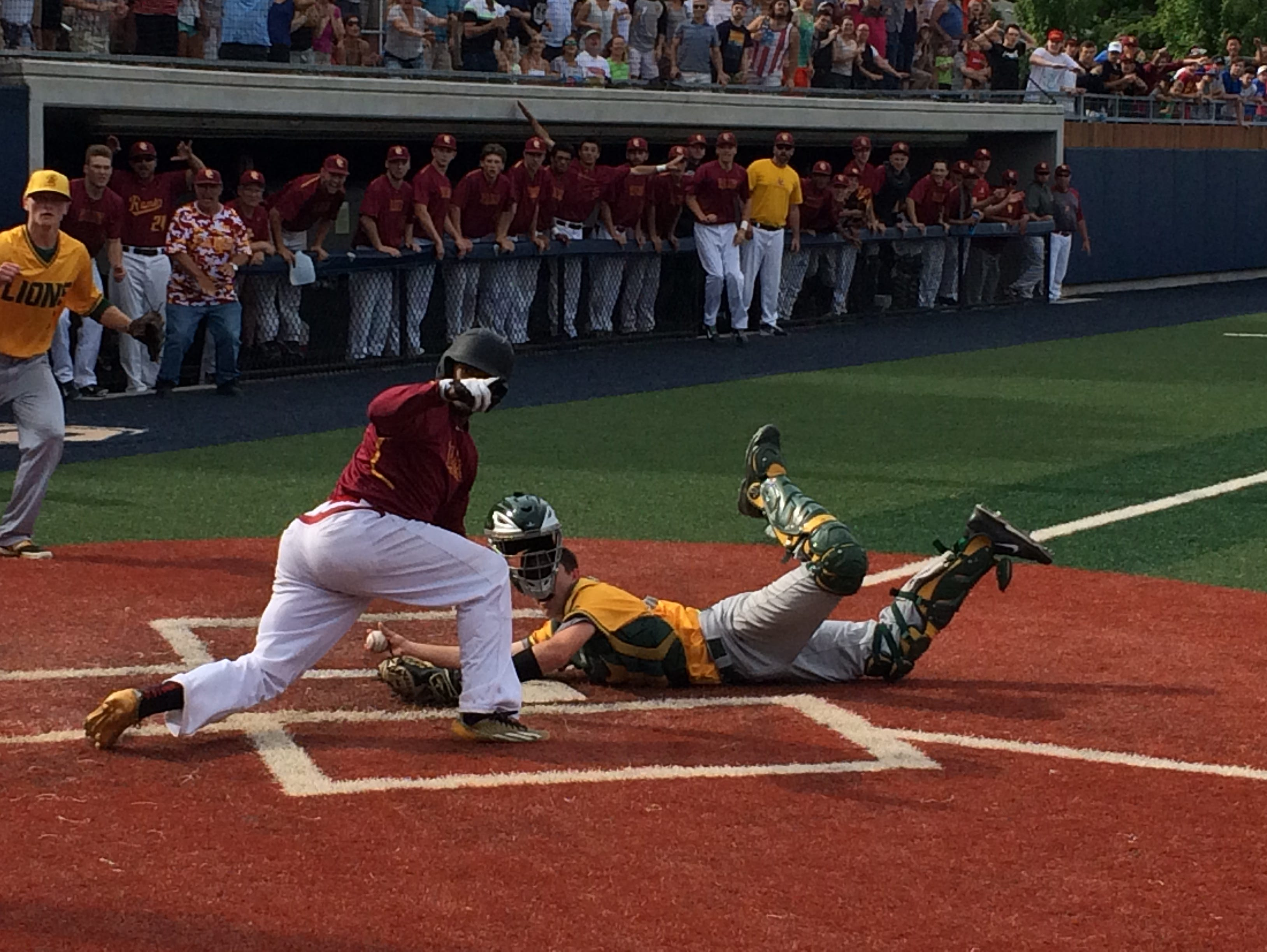 Central Catholic's Tyson Cooper just beats the tag for an inside the park home run against West Linn.