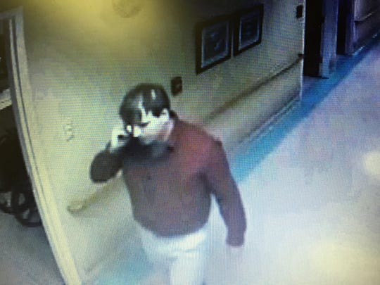 Clayton Kelly is shown in surveillance video from Easter Sunday 2014 in the hallway near the late Rose Cochran's nursing home room.
