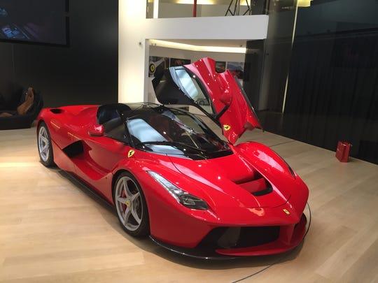 A Ferrari LaFerrari sits in the company's showroom