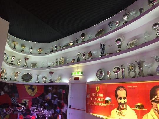 A wall of racing trophies won by Ferrari racing teams