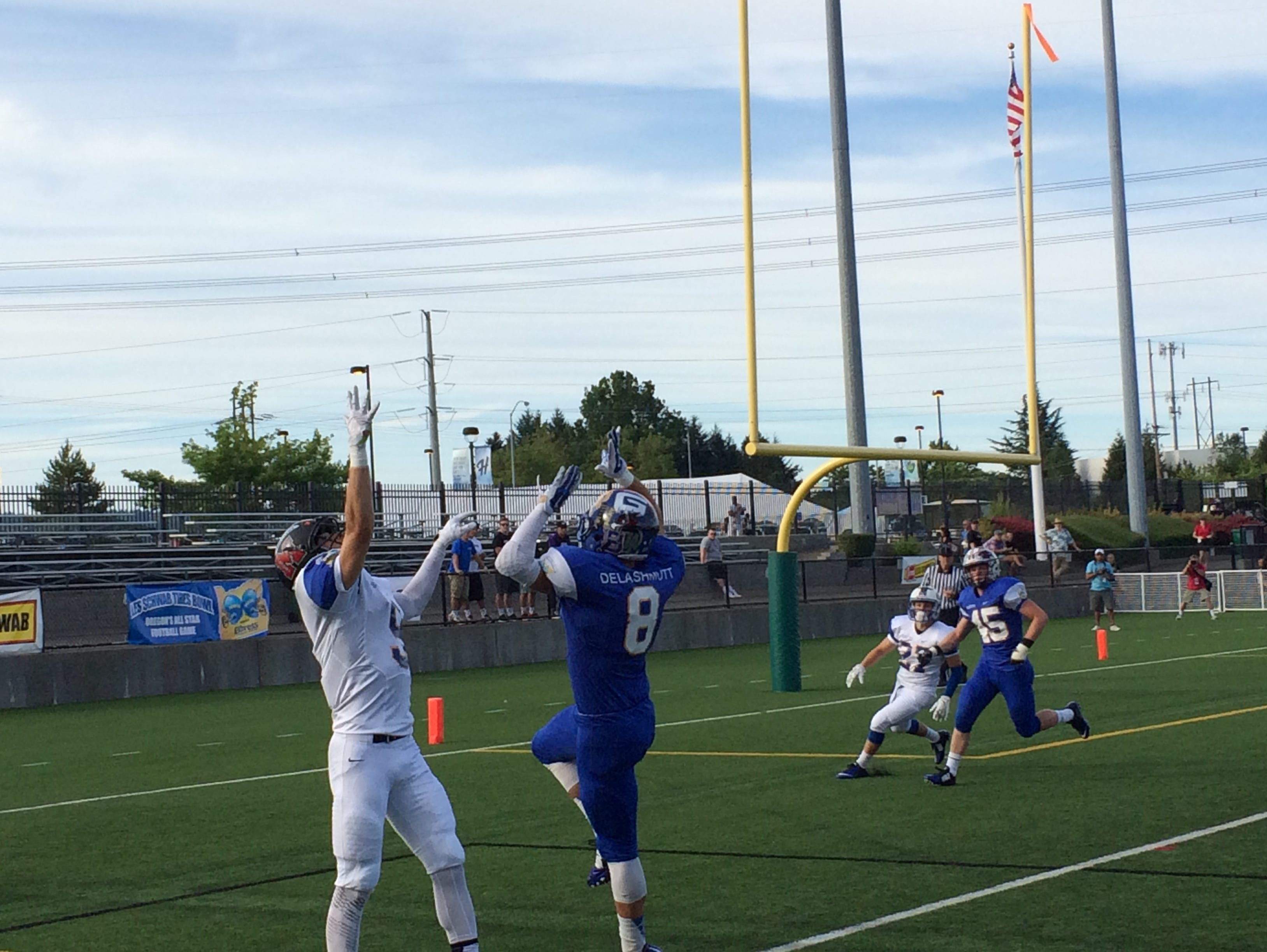 Tigard's Brady McGetrick attempts to make a catch for the South against Newberg's Tyler Delashmutt of the South.