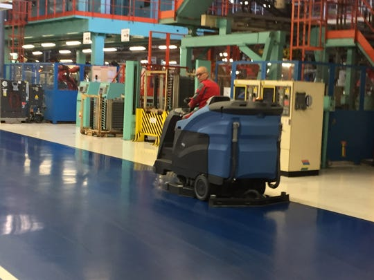 A man cleans the floors of FCA's Jeep plant in Melfi