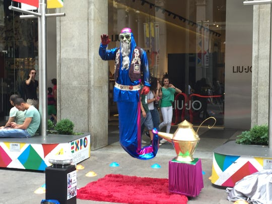 A street entertainer in Milan, Italy, brings creativity