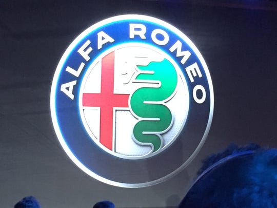The revised and updated Alfa Romeo logo, which traces its roots to the crest of a royal family in Milan and the city's coat of arms.