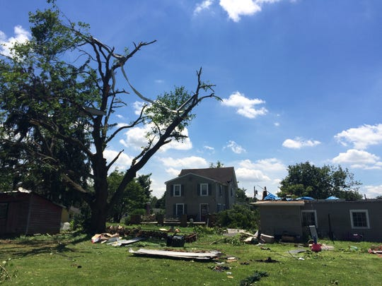 The corrugated roof from Terry Bowne' Weatherby Avenue garage were whipped high into trees and onto neighbors' roofs,