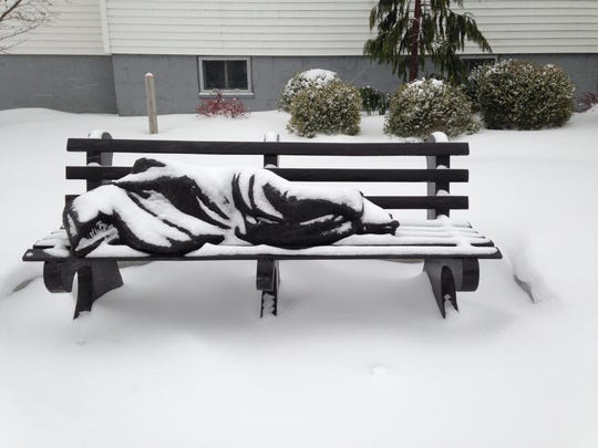"""St. John Episcopal Church in Grand Haven has installed a """"Homeless Jesus"""" sculpture"""
