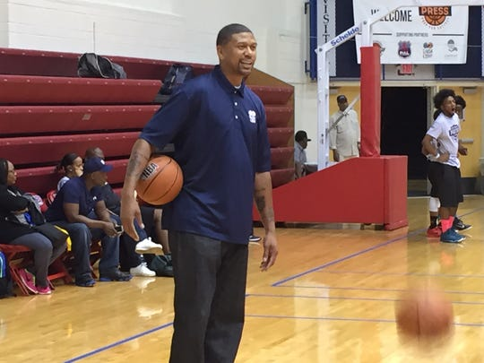 "Jalen Rose, a former Michigan ""Fab Five"" star, mentors children at the ""Full Court Press: Prep for Success"" program at Calihan Hall on June 27, 2015."