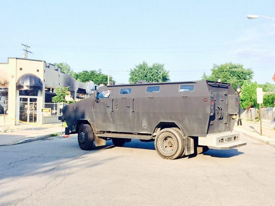 An armored vehicle sits at Beaconsfield and Charlevoix in Grosse Pointe Park after police got a call of a barricaded gunman that turned out to be a hoax.