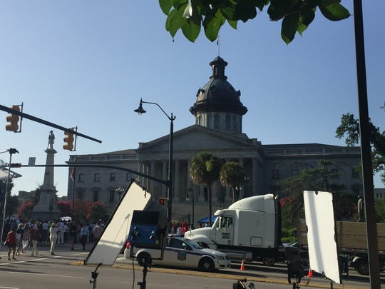 The scene as onlookers arrive to view the Confederate flag's removal.