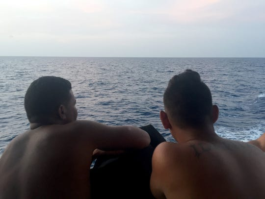 Cuban rafters stare toward Key West after they were