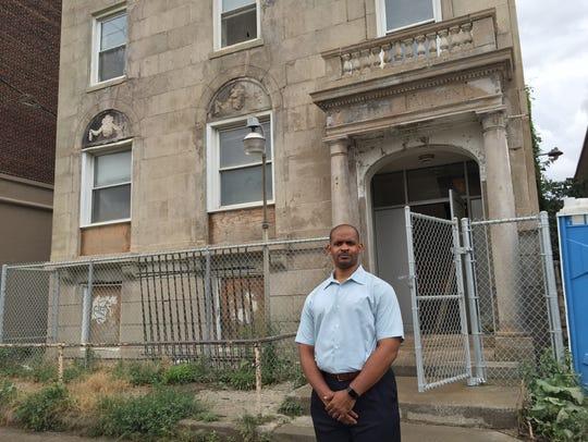 Brandon Duckett stands in front of his 678 Selden apartment