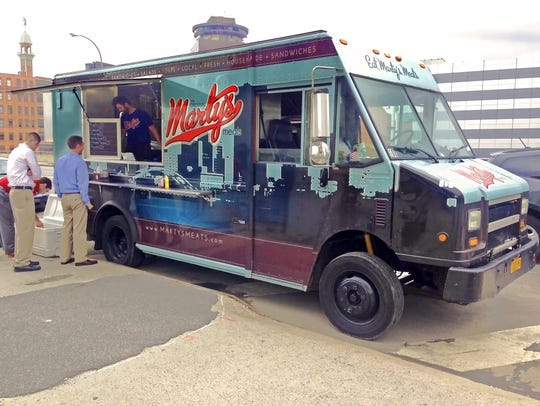 Marty's Meats serves customers in downtown Rochester