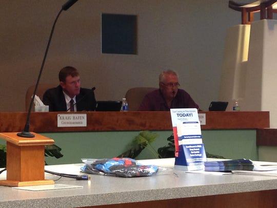 Mesquite City Councilmen George Rapson, right, and Kraig Hafen speak on the fee reduction.