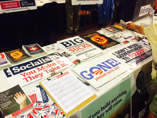 Posters, stickers, and buttons from the Turning Point USA table at the 2015 Family Leadership Summit.