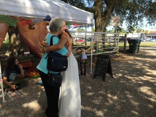 Melodie McMath (right) gives out a free hug at the