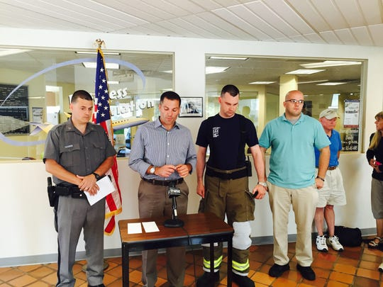 Dutchess County Executive Marc Molinaro, flanked by emergency officials, discusses Saturday morning's single-engine plane crash at Dutchess County Airport.
