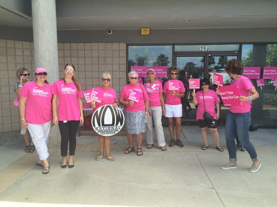 Pro-life protesters pose in front of Planned Parenthood