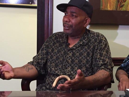 Herman Turner, Raynette Turner's husband, speaks at