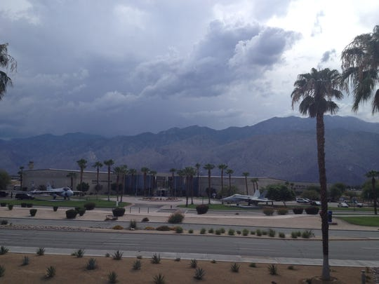 This file photo shows thunderstorms developing over Palm Springs. Humid conditions are expected this week and higher elevations may have thunderstorms that produce small amounts of rain, experts say.