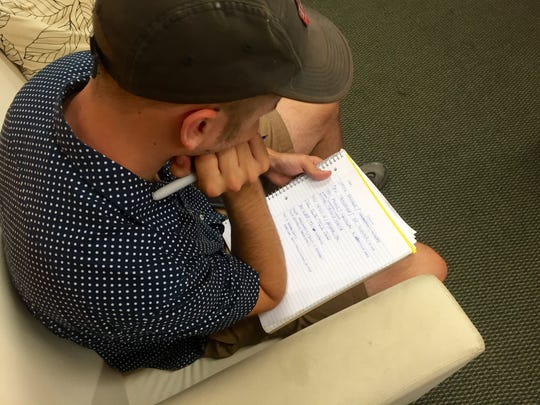 The Collective Brain is blowing past their deadline in the 48 Hour Film Project. They still need to add credits and some release forms are missing. Jake Huber jots down names in his notebook.