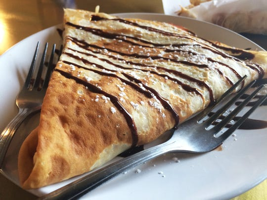 The Seventh Habit crêpe is custard-filled with strawberries or bananas and covered in powdered sugar and chocolate sauce.