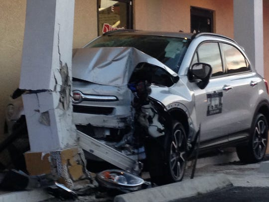 Two people were transported to a local hospital after a driver crashed into a building in Cape Coral.