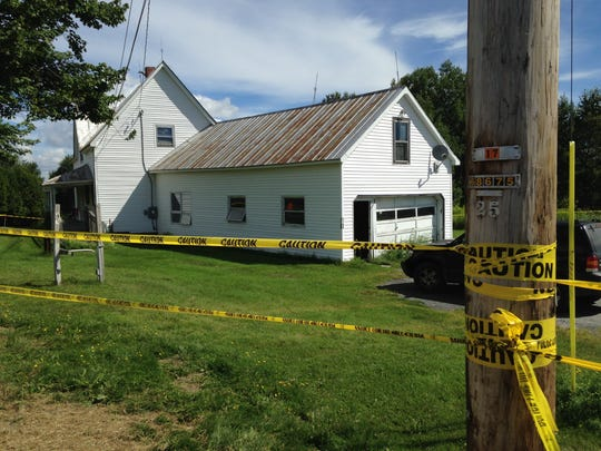 Police tape surrounds a home at 3182 Airport Road in