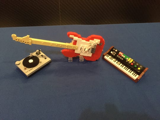 A turntable, guitar and keyboard, all made by Master