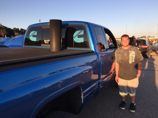"""Tyler Teague with his 2001 Dodge Ram 2500 at """"Roadkill Nights,"""" a drag racing event sponsored by Dodge."""