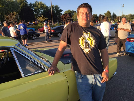"""Brandon Phillips with his 1969 Dodge Super Bee at """"Roadkill Nights"""" sponsored by Dodge before winning a drag racing contest."""