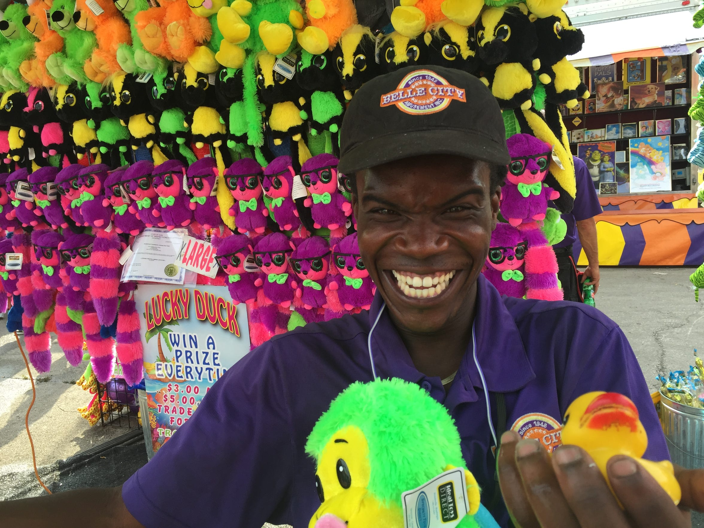 Jamarkus Walton tends to the Lucky Duck game on the Iowa State Fair Midway.
