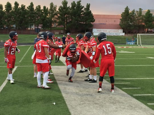 Members of the Dixie State football team practice at