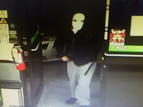 Surveillance photo of robber at the Mobil On The Run,