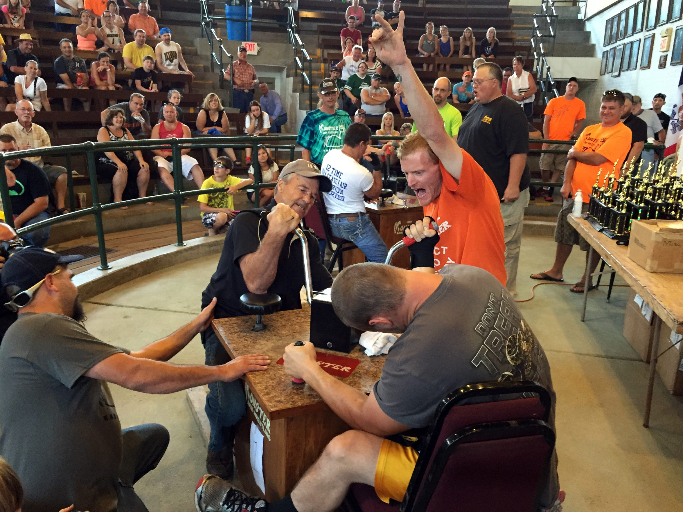 Bill Johnson of Avoca, 73, facing the camera, competes in the Monster Arm Wrestling Championships at the Iowa State Fair on Sunday, Aug. 16, 2015.