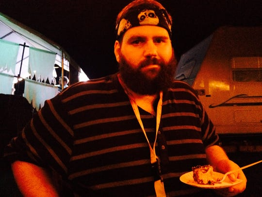 Mike Leclerc, 31, of Warren with his special Kahlua-infused tiramisu recipe Friday, Aug. 14, 2015 at the 6th annual Michigan Homebrew Festival.