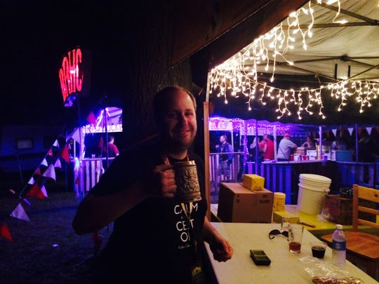 Chris Shonk, 29, of Detroit drinks beer from a mug Friday, Aug. 14, 2015 at the 6th annual Michigan Homebrew Festival.