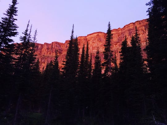 The sunrise reflects on the Chinese Wall in the Bob Marshall WIlderness in late July.