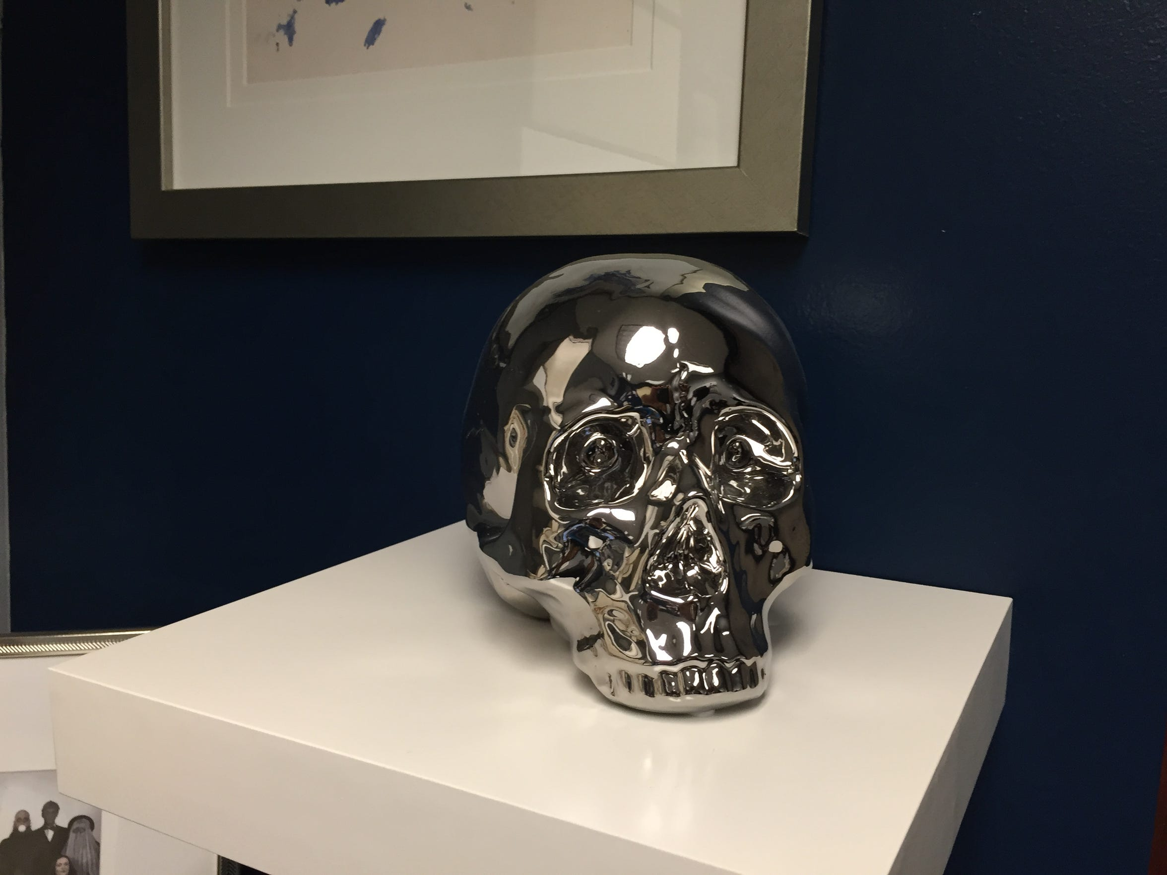 "The ""lazy worker skull"" sits as a warning in the corner of Shawn Head's office."