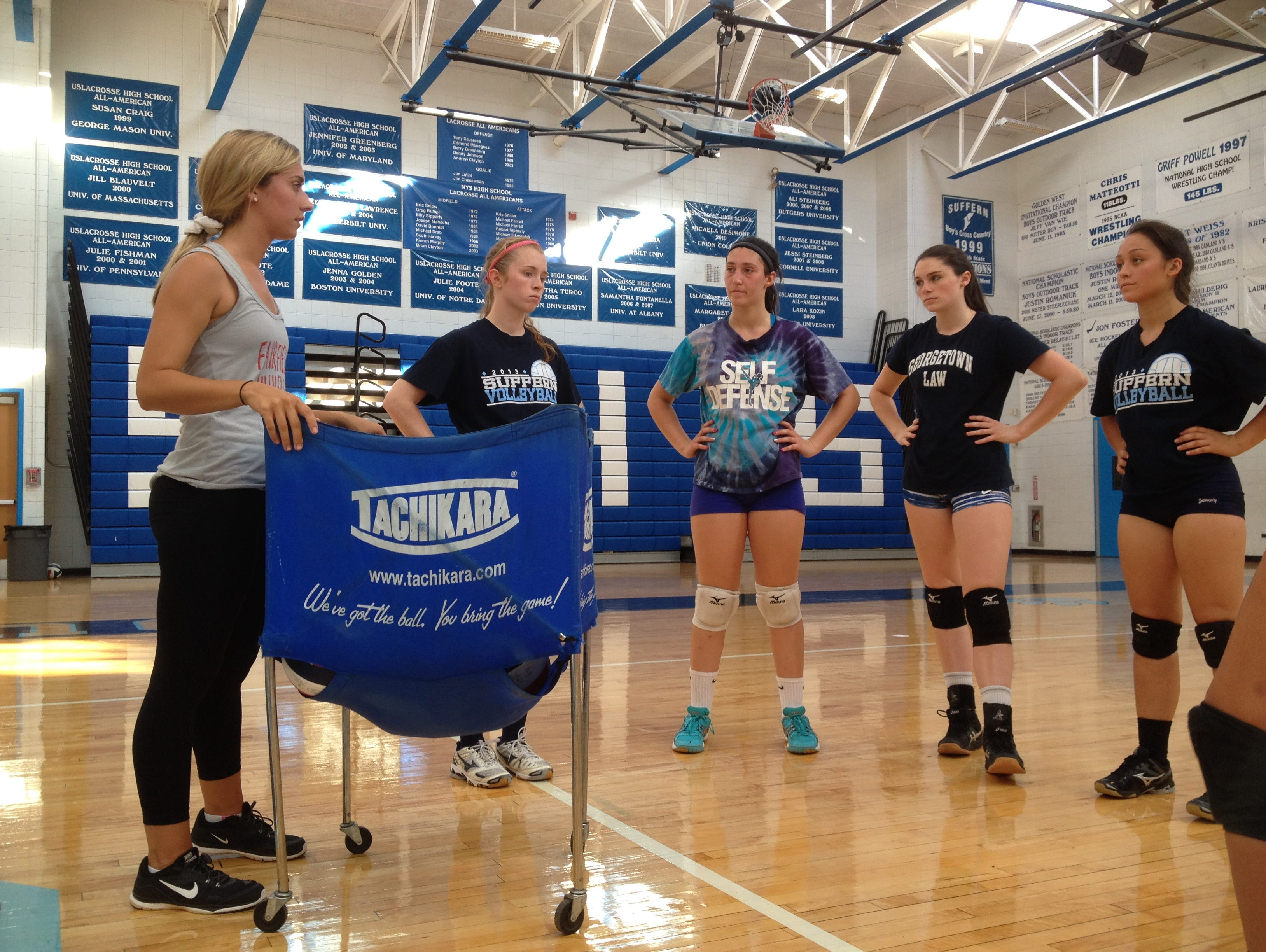 Suffern head coach Samantha Gutmann talks to her players during a team practice on Aug. 21, 2015.