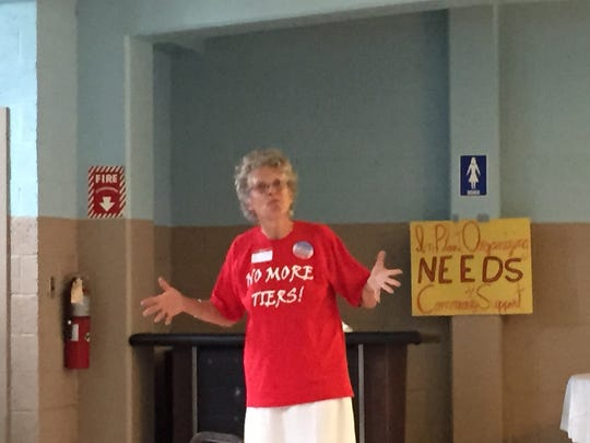 Wendy Thompson, a member  of Autoworker Caravan speaks at a meeting Sunday