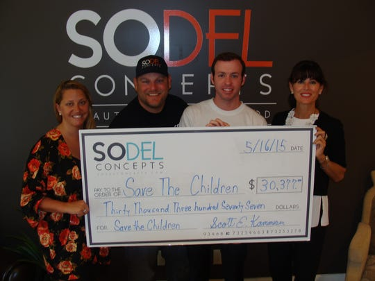 SoDel Concepts organized a fundraiser on May 15 to benefit Save the Children, which is providing aid to earthquake victims in Nepal. Scott Kammerer presents a $30,000 check.