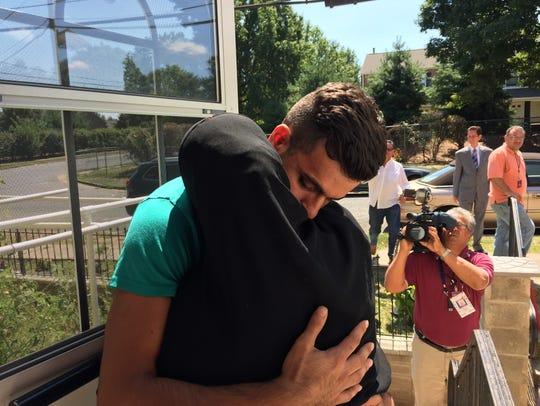 Ibtesam Alasmar hugs her son Imad Alasmar, 21 on Wednesday.