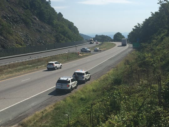 Waynesboro Police stage on Afton Mountain I-64 near mile marker 99 in search of the suspect wanted in the shooting of WDBJ7's photographer Adam Ward and reporter Alison Parker were killed in the incident.