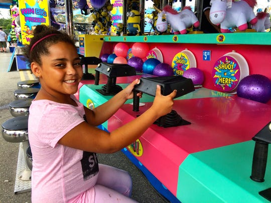 Gina Love, 8, attempts to win a prize at the Dutchess County Fair in Rhinebeck on Aug. 30, 2015.