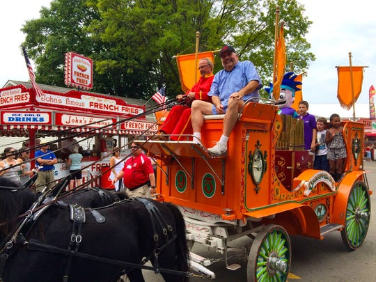 A horse and carriage makes its way through the Dutchess County Fair Sunday.