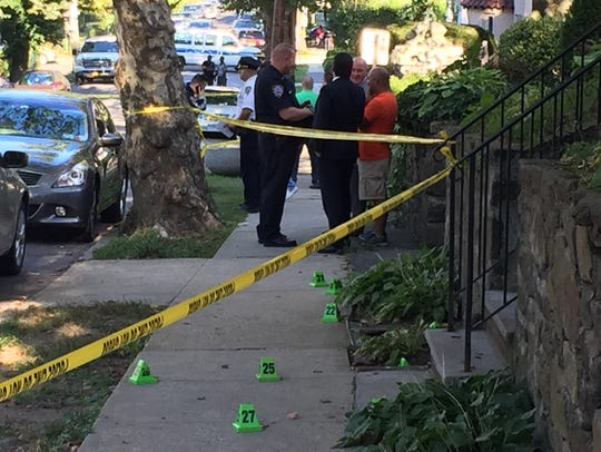 Police investigate a shooting involving NYPD officers