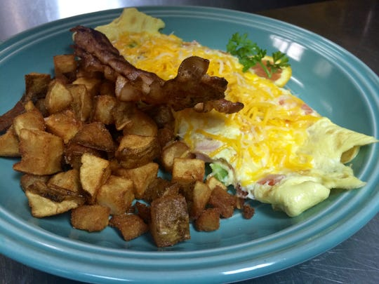 An omelet with bacon and hand-cut breakfast potatoes from RoJo's.