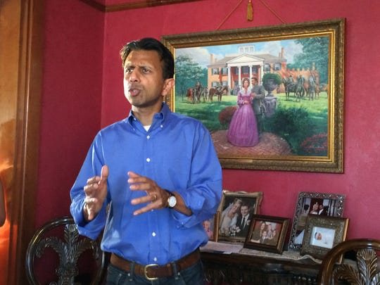 Gov. Bobby Jindal speaks to a crowd of people at the Leonard farm in Holstein during a meeting with the Iowa Federation of Republican Women Wednesday evening.