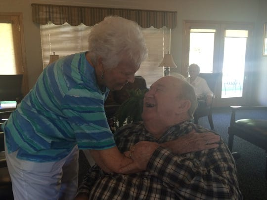 Jan Dawson and Karl Brooks share memories of Dawson's dog, Maggie, while visiting at Ridgeview Gardens Assisted Living Center.