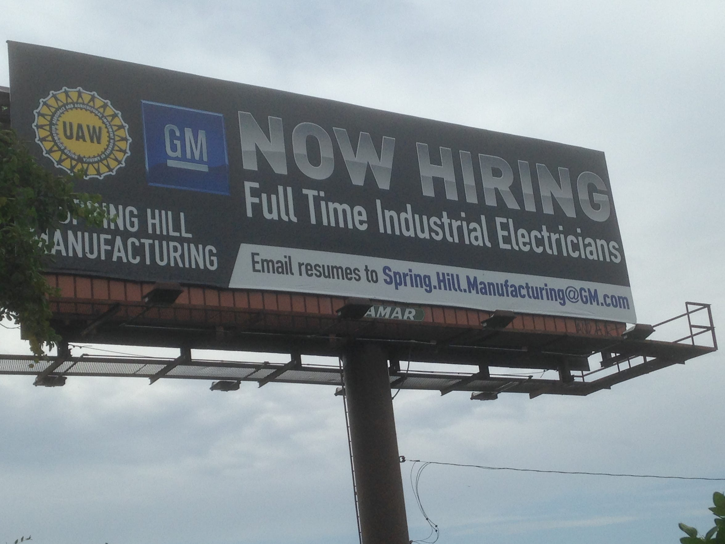 This UAW GM billboard is located on the north side of Lee Victory Parkway about a half mile from the Nissan auto factory in Smyrna. The billboard seeks to attract full-time industrial electricians to the GM factory in Spring Hill.